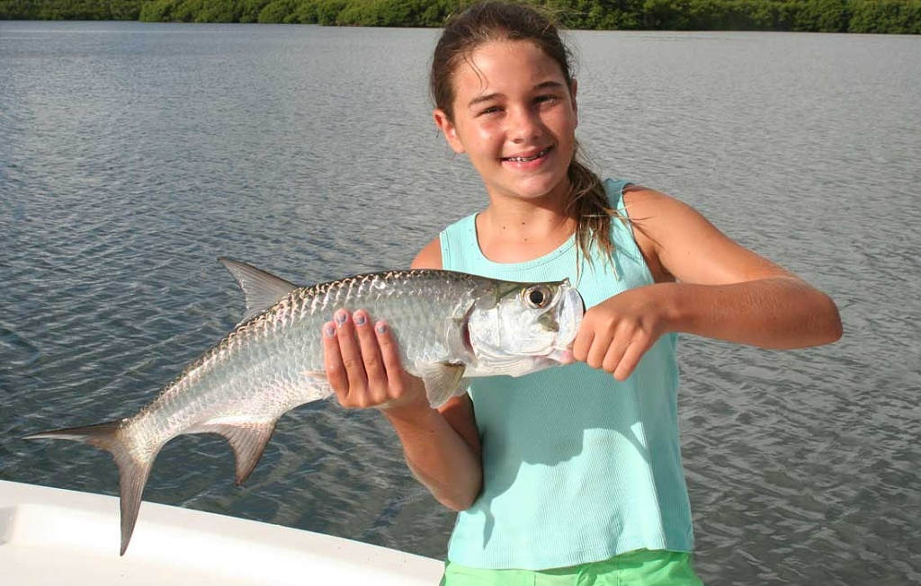 Happy Girl With First Tarpon